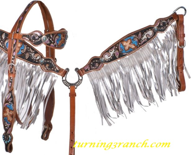 Breast collar is accented with leather metallic silver fringe. Base color  of set is black stingray with turquoise and purple accents